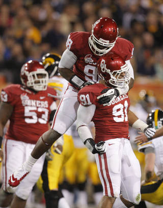 CELEBRATION: Oklahom's Chuka Ndulue (98) and R.J. Washington (91) celebrate a sack during the Insight Bowl college football game between the University of Oklahoma (OU) Sooners and the Iowa Hawkeyes at Sun Devil Stadium in Tempe, Ariz., Friday, Dec. 30, 2011. Photo by Sarah Phipps, The Oklahoman