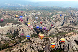 "A majestic balloon ride in central Turkey can take you over the eroded ""badlands"" of Cappadocia.Photo by Rick Steves"
