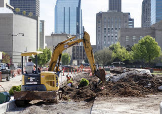 Construction crews clear the Civic Center park as part of a controversial make-over designed by architect Rand Elliott and Tulsa-based landscape architecture firmn PDG Inc. PAUL HELLSTERN - Oklahoman