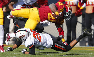 Oklahoma State 's Tyler Patmon (26) brings down Iowa State's Shontrelle Johnson (21) during the college football game between the Oklahoma State University Cowboys (OSU) and the Iowa State University Cyclones (ISU) at Jack Trice Stadium in Ames, Iowa, on Saturday, Oct. 26, 2013. Photo by Chris Landsberger, The Oklahoman
