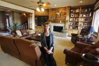 Denise Patterson is shown in her living room at 18270 N Antler Way in the Deer Creek area. Steve Gooch - The Oklahoman