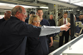 Gov. Mary Fallin assists with starting up the new press at Quad/Graphics' Oklahoma City plant. Photo provided