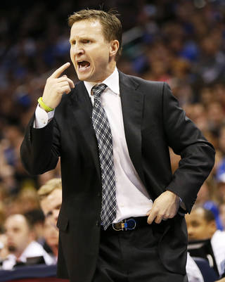 Oklahoma City coach Scott Brooks coaches from the sideline during an NBA basketball game between the Oklahoma City Thunder and the San Antonio Spurs at Chesapeake Energy Arena in Oklahoma City, Thursday, April 4, 2013. The Thunder won 100-88. Photo by Nate Billings, The Oklahoman NATE BILLINGS