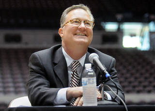 Barry Hinson smiles up at the crowd of fans in attendance at his introduction as Southern Illinois men's basketball coach Wednesday, March 28, 2012, in Carbondale, Ill. (AP Photo/Southern Illinoisan, Steve Jahnke) ORG XMIT: ILCAR303