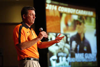 Oklahoma State football coach Mike Gundy talks to OSU fans as part of the Cowboy Caravan at the Renaissance Tulsa hotel on Monday, August 11, 2014. MATT BARNARD/Tulsa World