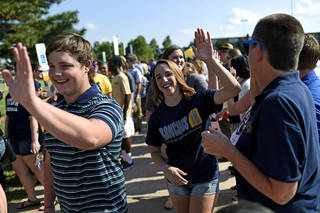 University faculty and staff greet members of the University of Central Oklahoma's class of 2018 as they enter freshman convocation. More than 150 faculty and staff were on hand to welcome new students. PHOTO PROVIDED BY UCO