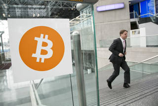 A man arrives for the Inside Bitcoins conference and trade show in April in New York. AP File Photo Mark Lennihan - AP
