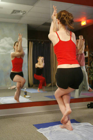 Kelly Hacker and others participate in a Bikram (hot) Yoga class at 6710 N Classen in Oklahoma City, Okla., Saturday, February 24, 2007. Photo by Paul Hellstern / The Oklahoman. ORG XMIT: KOD