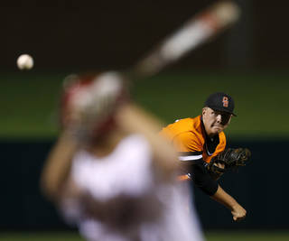 Oklahoma State's Tyler Buffett pitches during an NCAA college baseball game against Oklahoma in the Big 12 baseball tournament at the Chickasaw Bricktown Ballpark in Oklahoma City, Friday, May 23, 2014. (AP Photo/The Oklahoman, Nate Billings)