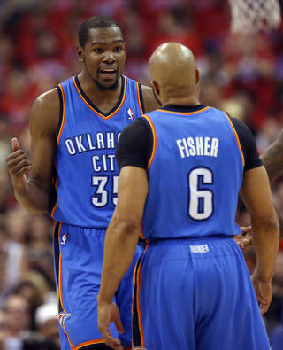 Oklahoma City's Kevin Durant (35) and Derek Fisher (6) talk during Game 6 of the Western Conference semifinals in the NBA playoffs between the Oklahoma City Thunder and the Los Angeles Clippers at the Staples Center in Los Angeles, Thursday, May 15, 2014. Photo by Nate Billings, The Oklahoman