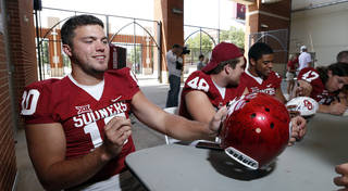 Tight end Blake Bell signs autographs during the University of Oklahoma (OU) football team's annual Meet the Sooners day at Gaylord Family/Oklahoma Memorial Stadium Saturday, Aug. 2, 2014 in Norman, Okla. Photo by Steve Sisney, The Oklahoman