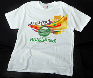 "The new T-shirts are similar to the medals, with the Marathon's new logo and the round Survivor Tree logo over ""Run to Remember."" Photo by Sarah Phipps, The Oklahoman"