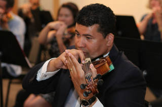 "Guests can learn the basics of playing the violin in a relaxed setting at the Oklahoma City Philharmonic's ""Violins & Vino"" event Thursday. Photo provided"