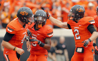 CELEBRATION: Oklahoma State's J.W. Walsh (4), Josh Stewart (5) and Oklahoma State's Caleb Muncrief (2) celebrate a Stewart touchdown during a college football game between Oklahoma State University (OSU) and the University of Louisiana-Lafayette (ULL) at Boone Pickens Stadium in Stillwater, Okla., Saturday, Sept. 15, 2012. Photo by Sarah Phipps, The Oklahoman