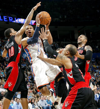 Oklahoma City's Russell Westbrook missed this shot as he is pressured by Toronto's defense during their NBA basketball game at the OKC Arena in downtown Oklahoma City on Sunday, March 20, 2011. Photo by John Clanton, The Oklahoman