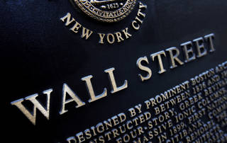This historic marker is on Wall Street in New York. AP File Photo Mark Lennihan