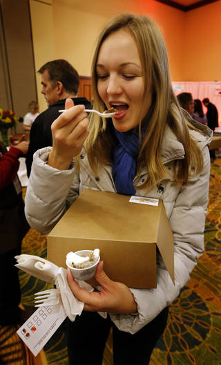 German-born University of Oklahoma student Yvonne Dijkstra samples an offering at the Firehouse Art Center's annual Chocolate Festival in Norman. PHOTO BY STEVE SISNEY, THE OKLAHOMAN STEVE SISNEY
