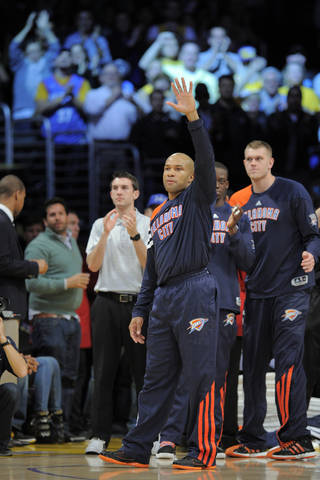 Oklahoma City Thunder guard Derek Fisher waves to fans as they cheer him prior to the Thunder's NBA basketball game against the Los Angeles Lakers, Thursday, March 29, 2012, in Los Angeles. Fisher signed with the West-leading Thunder last week, shortly after he was traded to Houston by the Lakers and subsequently bought out of his contract instead of playing for the Rockets. (AP Photo/Mark J. Terrill) ORG XMIT: LAS105