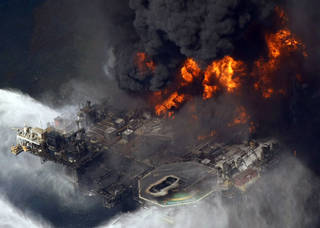 In an April 21, 2010, photo, the Deepwater Horizon oil rig burns after a deadly explosion in the Gulf of Mexico.(AP Photo) Gerald Herbert