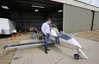 Sundance Airport CEO Jerry Hunter looks at a FLS Microjet that is hangared at the northwest Oklahoma City airport, which he recently purchased. Photo by Steve Gooch, The Oklahoman Steve Gooch