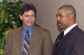 Current Brewers general manager Doug Melvin, left, was the Texas Rangers' general manager from 1994-2001. Here he talks with former RedHawks manager DeMarlo Hale. Photo by The Oklahoman Archive
