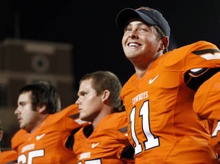 OSU quarterback Wes Lunt (11) smiles as the team sings the alma mater after a college football game between Oklahoma State University and Savannah State University at Boone Pickens Stadium in Stillwater, Okla., Saturday, Sept. 1, 2012. OSU won, 84-0. Photo by Nate Billings, The Oklahoman