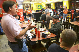 Bryan Hull, a founding director of Oklahoma Open Carry Association, addresses a crowd that showed up at Beverly's Pancake House early Thursday to mark the state's transition from a concealed carry one to an open carry one. PHOTO BY ZEKE CAMPFIELD, THE OKLAHOMAN