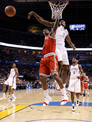 Oklahoma City's Serge Ibaka (9) blocks the shot of Milwaukee's Brandon Jennings (3) during the NBA basketball game between the Oklahoma City Thunder and the Milwaukee Bucks at the Oklahoma City Arena, Wednesday, April 13, 2011. Photo by Bryan Terry, The Oklahoman