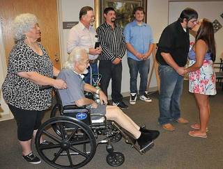 Emilio Gonzalez and Ashley Rocho wed in the waiting room at Southwestern Medical Center in Lawton so his grandfather, Ronnie Riley, could attend. (Lawton Constitution photo)
