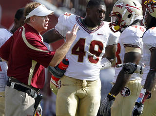 Florida State defensive coordinator Mark Stoops talks to his defense during the first half of the college football game between the University of Oklahoma Sooners (OU) and the Florida State University Seminoles (FSU) on Sat., Sept. 11, 2010, in Norman, Okla. Photo by Chris Landsberger, The Oklahoman ORG XMIT: KOD
