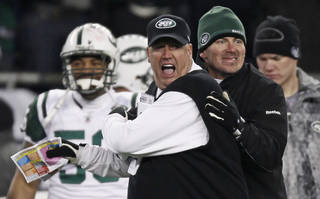 New York Jets coach Rex Ryan, center, reacts near the end of the Jets' 28-21 win over the New England Patriots in an AFC divisional playoff NFL football game in Foxborough, Mass., Sunday, Jan. 16, 2011. (AP Photo/Winslow Townson) ORG XMIT: FBO157