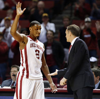 Oklahoma Sooners' Steven Pledger (2) waves to the crowd and greets Oklahoma Sooner head coach Lon Kruger near the end of the second half as the University of Oklahoma Sooners (OU) men defeat the Iowa State Cyclones 86-69 in NCAA, college basketball at The Lloyd Noble Center on Saturday, March 2, 2013 in Norman, Okla. Photo by Steve Sisney, The Oklahoman