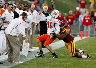Iowa State's Bailey Johnson (85) is called for a horse collar tackle of Zac Robinson (1) in the second half during the college football game as the Oklahoma State University (OSU) Cowboys play the Iowa State University (ISU) Cyclones at Jack Trice Stadium on Saturday, November 7, 2009, in Ames, Iowa. Photo by Steve Sisney, The Oklahoman ORG XMIT: KOD