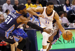 Oklahoma City's Jeremy Lamb (11) takes the ball past Charlotte's Hakim Warrick (21) during an NBA basketball game between the Oklahoma City Thunder and Charlotte Bobcats at Chesapeake Energy Arena in Oklahoma City, Monday, Nov. 26, 2012. Oklahoma City won, 114-69. Photo by Nate Billings , The Oklahoman