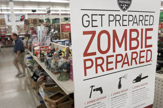 FILE - In this Monday, Oct. 10, 2011 file photo, a sign promoting zombie preparedness displays in a hardware store in Omaha, Neb. After several gory incidents that have been reported around the country recently, online zombie talk has grown. (AP Photo/Nati Harnik, File)