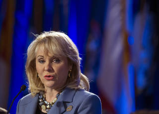 National Governor's Association chair Oklahoma Gov. Mary Fallin addresses the morning session of the NGA's Winter Meeting in Washington, Saturday, Feb. 22, 2014. (AP Photo/Cliff Owen)