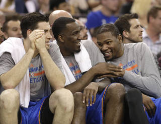 The Thunder's Nick Collison, left, Kendrick Perkins, center and Kevin Durant relax on the bench during the closing moments of Oklahoma City's 107-92 win over Sacramento late Tuesday night in Sacramento, Calif. Wednesday's Thunder-Clippers game finished after press time for this edition. AP photo