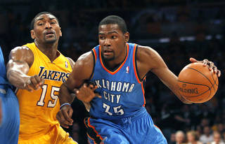Oklahoma City's Kevin Durant (35) dribbles past Los Angeles' Metta World Peace (15) during Game 3 in the second round of the NBA basketball playoffs between the L.A. Lakers and the Oklahoma City Thunder at the Staples Center in Los Angeles, Friday, May 18, 2012. Photo by Nate Billings, The Oklahoman