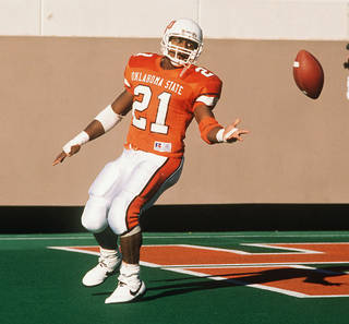 OKLAHOMA STATE UNIVERSITY / COWBOYS FOOTBALL: OSU running back Barry Sanders tosses the ball after his NCAA- record setting 30th touchdown. BY PAUL HELLSTERN.