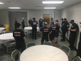 The 16-member Swift Water Rescue Team is being briefed on the Keystone water release. [Photo provided by the Oklahoma City Fire Department]