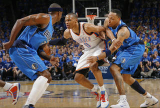 Oklahoma City's Russell Westbrook (0) dribbles away from Shawn Marion (0) of Dallas near Jason Terry (31) in the first half during game 4 of the Western Conference Finals in the NBA basketball playoffs between the Dallas Mavericks and the Oklahoma City Thunder at the Oklahoma City Arena in downtown Oklahoma City, Monday, May 23, 2011. Photo by Nate Billings, The Oklahoman