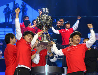 "FILE - In this Oct. 4, 2013 file photo, members of Korea's SK Telecom T1 team celebrate with their trophy after defeating China's Royal Club at the League of Legends Season 3 World Championship Final, in Los Angeles. A small private university in Chicago is offering hefty scholarship for players of League of Legends, which has become one of the most popular games for organized team competitions. Robert Morris University Illinois announced its new program this month and said it recognizes the growing legitimacy of what are known as ""eSports."" (AP Photo/Mark J. Terrill,File)"