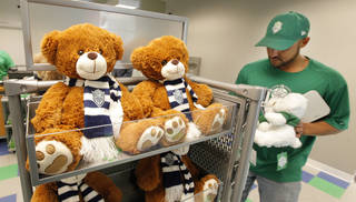 Teddy Bears with the Energy FC logo on them are stocked by store employee Mike Lummus. PAUL B. SOUTHERLAND -