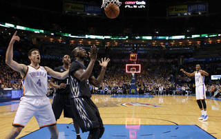 Oklahoma City's Nick Collison (4) reacts beside Minnesota's Gorgui Dieng (5) and Luc Richard Mbah a Moute (12) as the ball falls through the basket at the end of the third quarter in an NBA basketball game between the Oklahoma CIty Thunder and the Minnesota Timberwolves at Chesapeake Energy Arena in Oklahoma City, Wednesday, Feb. 5, 2014. Oklahoma City won 106-97. Photo by Bryan Terry, The Oklahoman
