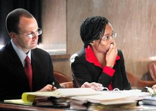 Exondia Salado, right, sits with an attorney in the Oklahoma County Courthouse Tuesday, March 22. Photo by Jim Beckel