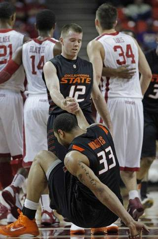 Oklahoma State's Keiton Page (12) helps Oklahoma State's Marshall Moses (33) up in the second half as the University of Oklahoma Sooner (OU) men's basketball team defeats the Oklahoma State University Cowboys (OSU) 64-61 at the Lloyd Noble Center on Saturday, March 5, 2011, in Norman, Okla. Photo by Steve Sisney, The Oklahoman STEVE SISNEY
