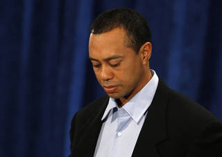 Tiger Woods makes a statement at the Sawgrass Players Club, Friday, Feb. 19, 2010, in Ponte Vedra Beach, Fla. (AP Photo/Joe Skipper, Pool) ORG XMIT: TWP101