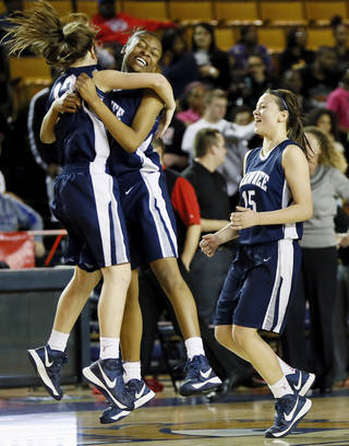 From left, Shawnee's Kelsey Simmons (13), Monique Tramble (33) and Niki Yu (15) celebrate after winning a Class 5A girls high school basketball game in the semifinals of the state tournament at the Mabee Center in Tulsa, Okla., Friday, March 8, 2013. Shawnee defeated Carl Albert, 50-46, in overtime. Photo by Nate Billings, The Oklahoman