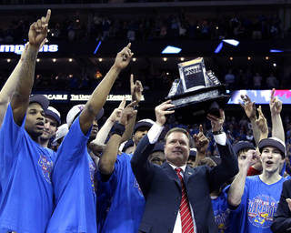 Kansas coach Bill Self holds up the trophy after defeating Texas 85-73 to win an NCAA college basketball game for the championship of the Big 12 men's basketball tournament Saturday, March 12, 2011, in Kansas City, Mo. (AP Photo/Charlie Riedel) ORG XMIT: MOOW110