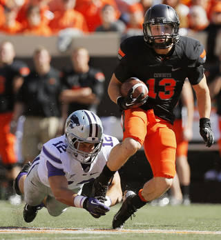 Oklahoma State's David Glidden (13) is stopped by Kansas State's Ty Zimmerman (12) after a catch in the second quarter during a college football game between the Oklahoma State University Cowboys (OSU) and the Kansas State University Wildcats (KSU) at Boone Pickens Stadium in Stillwater, Okla., Saturday, Oct. 5, 2013. Photo by Nate Billings, The Oklahoman